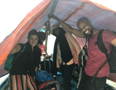 crew-in-rain-on-the-boat-to-lamu